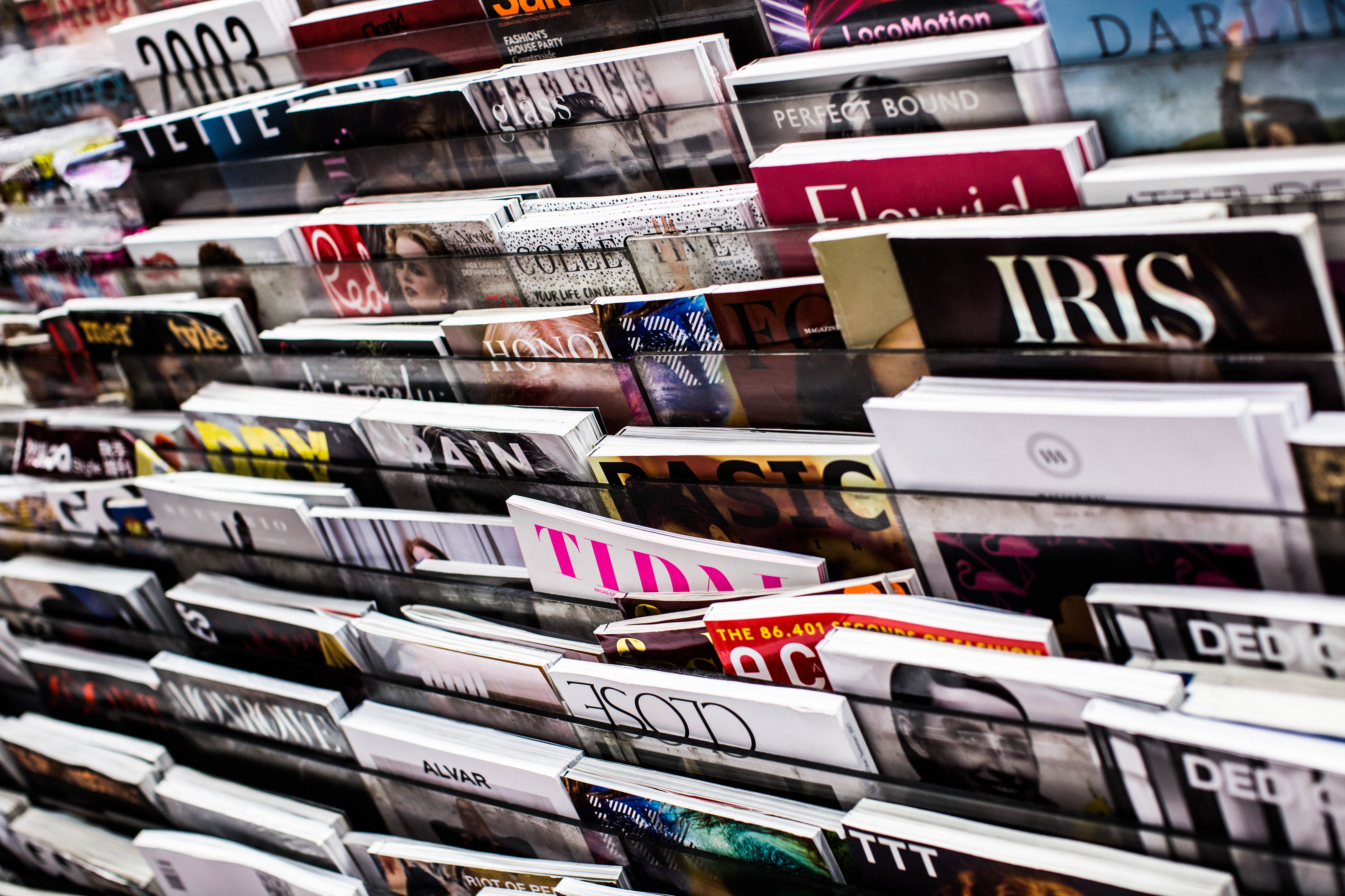 The image is of a rack filled with tons of magazines.