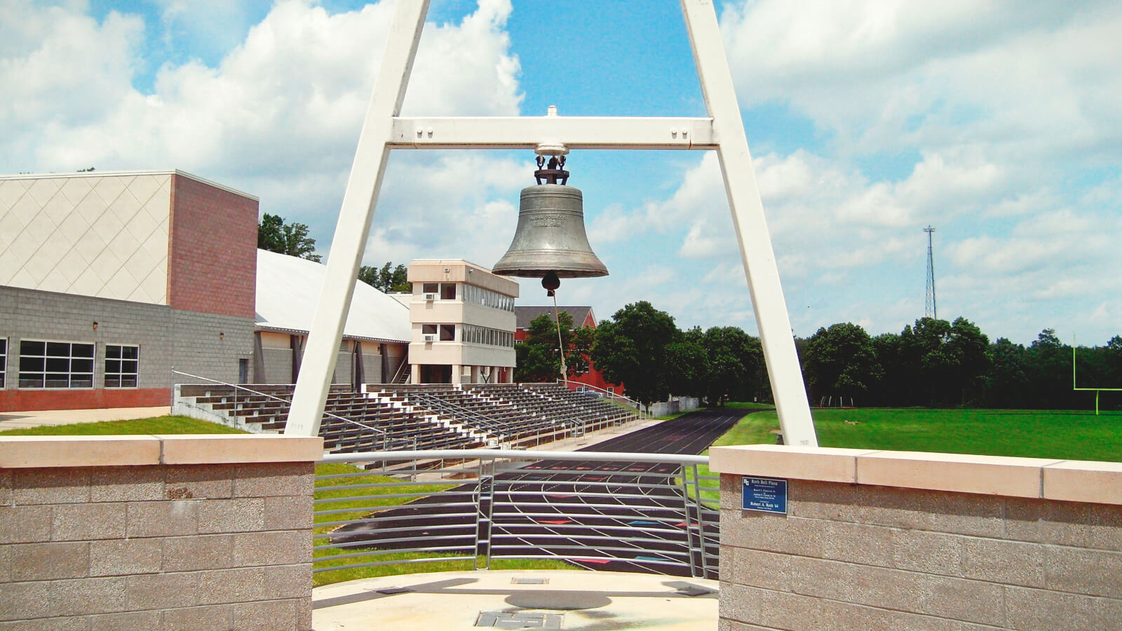 An image of a large bell in a stadium at Hiram College
