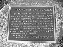 "A plaque commemorating the ""National Day of Mourning."""