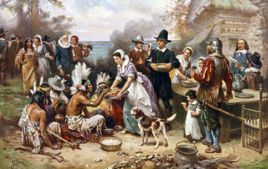 "The iconic ""The First Thanksgiving"" painting by Jean Louis Gerome Ferris where a pilgrim is handing food to a Native American Indian."