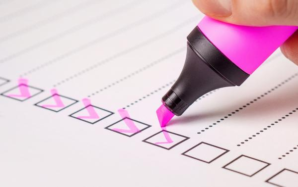 "A list of checklist items being marked ""done"" using a checkmark in pink highlighter"