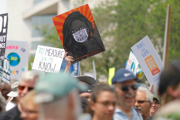 "A group of people gathered in the ""Peoples Climate March"" and holding signs that say, ""There Is No Planet B,"" ""Make the E.P.A. Great Again"" and ""To Measure Is To Know."""